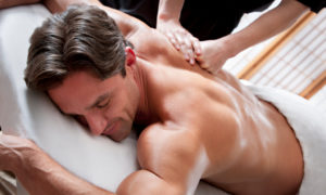massage on man at day spa